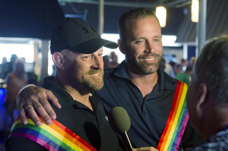 William Jones, left, and his partner, Aaron Huntsman, speak with the media Thursday, July 17. The couple is challenging the state of Florida's ban on gay marriage.  (Rob O'Neal/AP/Key West Citizen)