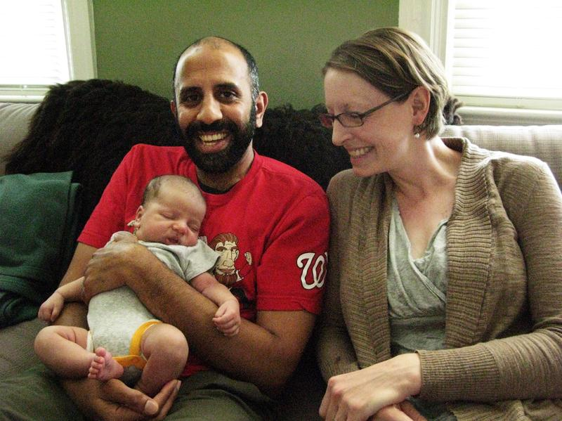 Kumar Chandran and Elanor Starmer with their son, Kailas Chandran. The couple's friends are envious of Chandran's paid paternity leave.