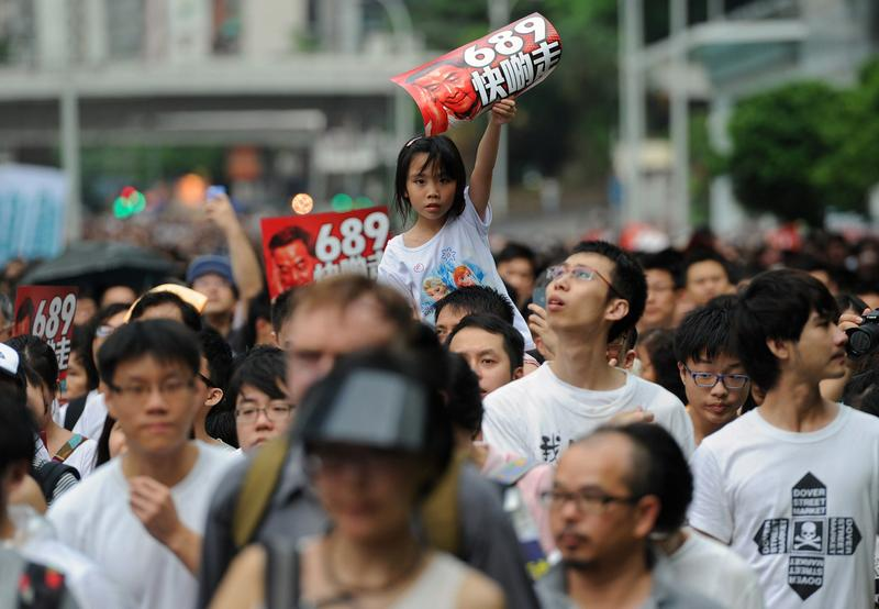A child holds up a banner during a pro-democracy rally seeking greater democracy in Hong Kong on July 1, 2014, as frustration grows over the influence of Beijing on the city. (Dale De La Rey/AFP/Getty)