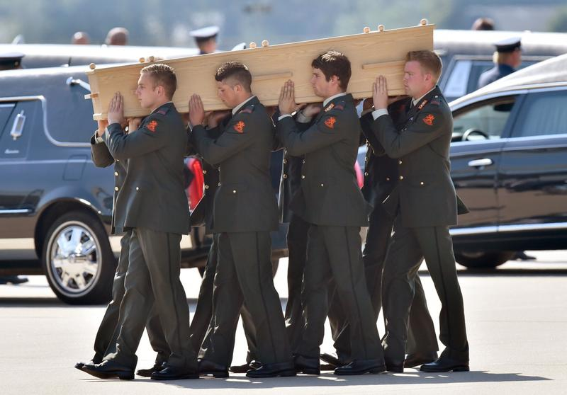Dutch military men carry coffins containing the remains of victims of downed Malaysia Airlines flight MH17, during a ceremony at Eindhoven Airbase on July 23, 2014, after a Hercules transport plane carrying the coffins landed from Ukraine. (John Thys/AFP/Getty Images)