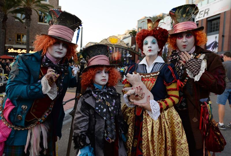 Costume designer and viral marketer Chad Evett (right) and members of his family are dressed as the Mad Hatter outside the San Diego Convention Center on the first day of the 45th annual Comic-Con, in San Diego, California July 24, 2014. (Robyn Beck/AFP/Getty Images)