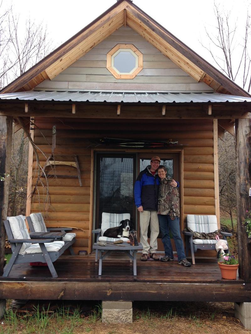 Rolf and Mari von Walthausen at their 12 x 16 square-foot cabin in Cedar, Michigan. (Emily Fox/Michigan Radio)