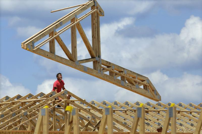 Construction workers build a commercial complex in Springfield, Ill., July 17, 2014. (Seth Perlman/AP)