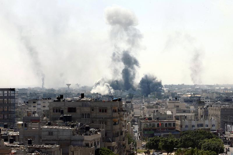 Smoke billows from buildings following an Israeli military strike east of Rafah in the southern Gaza Strip, on August 1, 2014. (Said Khatib/AFP/Getty Images)