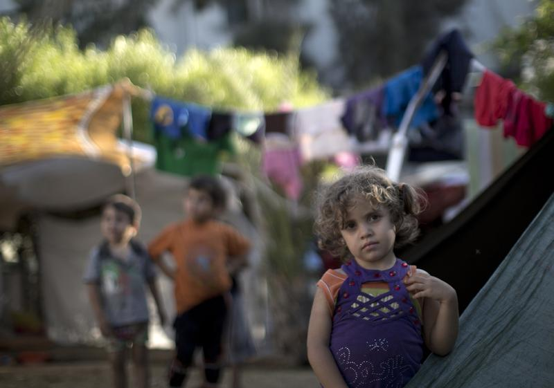 A displaced Palestinian girl stands next to a makeshift tent at the al-Shifa hospital in Gaza City where many Palestinians have have taken refuge after fleeing attacks in the Shejaiya neighbourhood of the city on July 31. With more than 220,000 Palestinians already sheltering in UN facilities -- four times the number from the last Gaza conflict in 2008-2009 -- the top UN refugee official Philippe Krahenbuhl said he had reached breaking point. (Mahmud Hams/AFP/Getty Images)