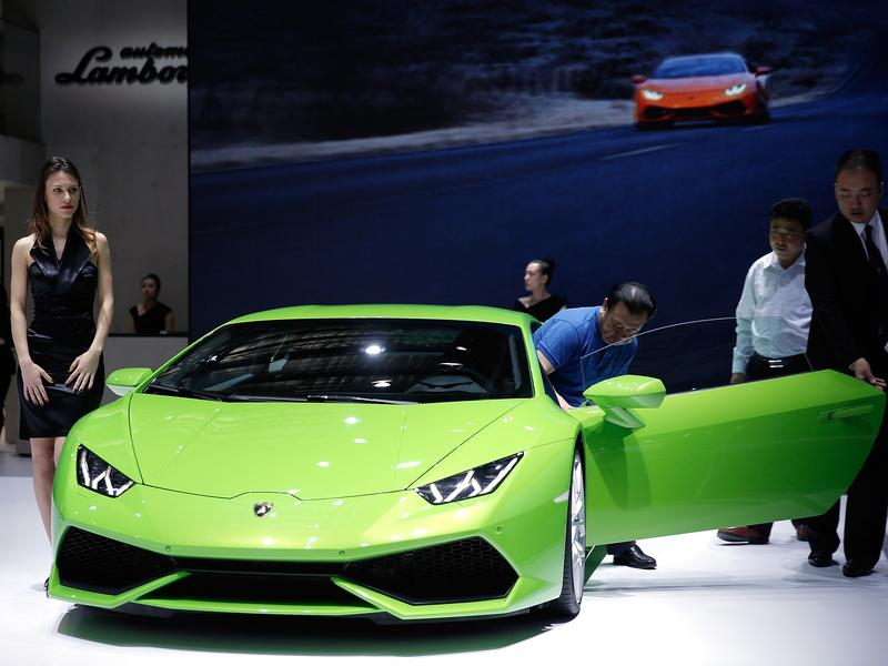 A Lamborghini sports car at the 2014 Beijing International Automotive Exhibition in April. A young Chinese man recently asked women on the street if they wanted to take a ride with him in his Lamborghini, and filmed the encounters.