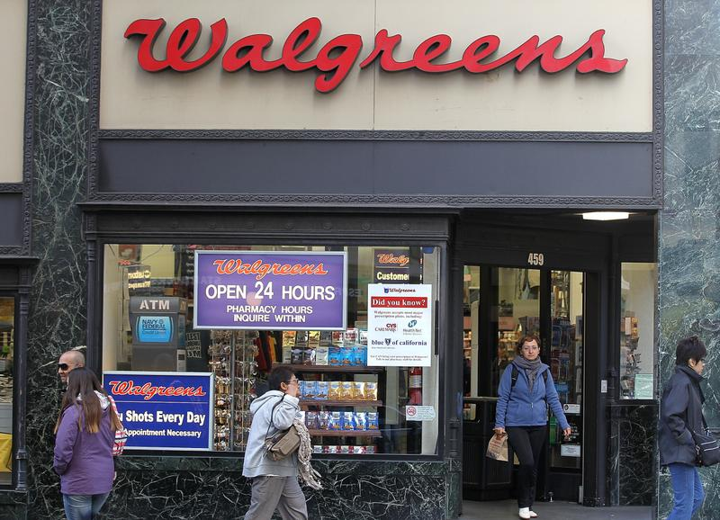 People walk by a Walgreens store on June 19, 2012 in San Francisco, California. U.S. based drug store chain Walgreens has announced a deal to purchase a 45 percent stake in European pharmacy retailer Alliance Boots for $6.7 billion. (Justin Sullivan/Getty Images)