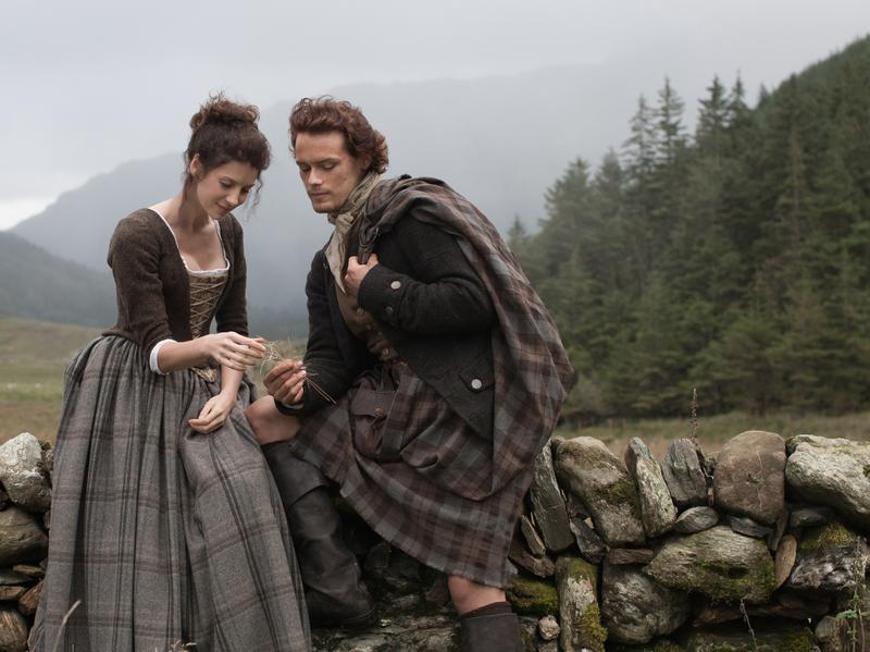 Caitriona Balfe as time-traveling Claire Randall, and Sam Heughan as her Highlander lover Jamie Fraser in the new television adaptation of <em>Outlander</em>.