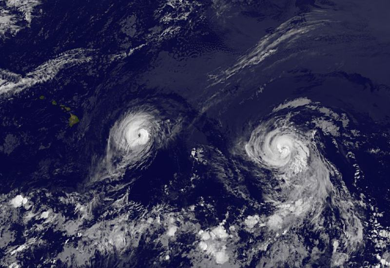 This image provided by NOAA taken Thursday Aug. 7, 2014 at 2 a.m. EDT shows Hurricane Iselle, left and Hurricane Julio. The center of Hurricane Iselle is expected to pass very near or over the Big Island Thursday night and just south of the smaller islands Friday. (NOAA)