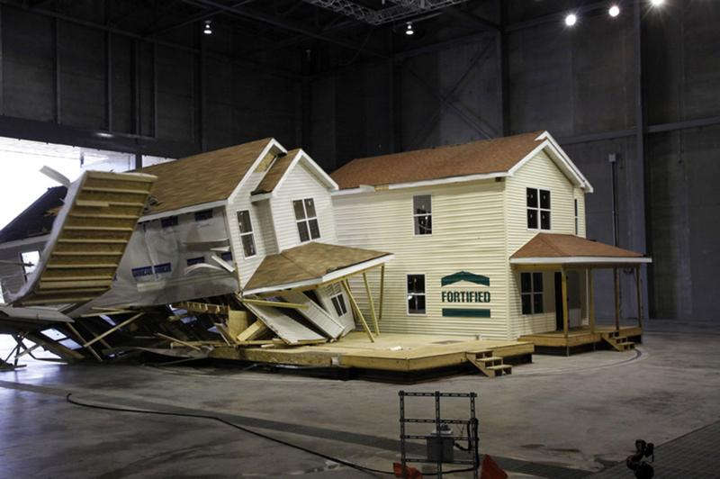 Pictured is a wind test demonstration by the Insurance Institute for Business and Home Safety, that subjected two full-scale houses to thunderstorm and straight-line wind conditions common in the Midwest. The homes are essentially the same, except that the house on the right was built to the IBHS FORTIFIED for Safer Living® standard for Midwest construction. (Scott Iskowitz/Insurance Institute for Business and Home Safety)
