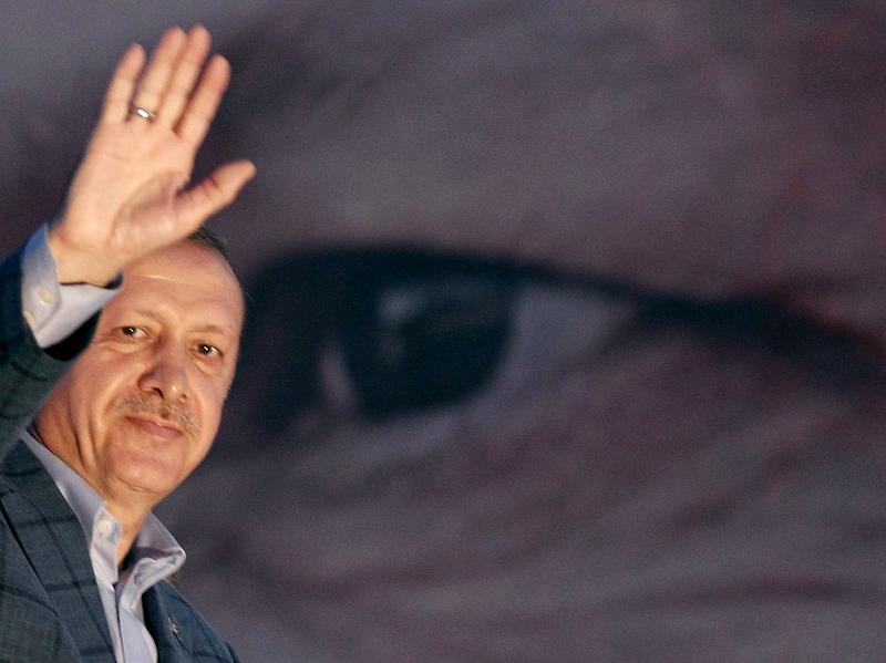 "Turkey's Prime Minister Tayyip Erdogan waves to the crowd in Istanbul on Sunday. He said the Turkish people had ""shown their will"" in electing him president."