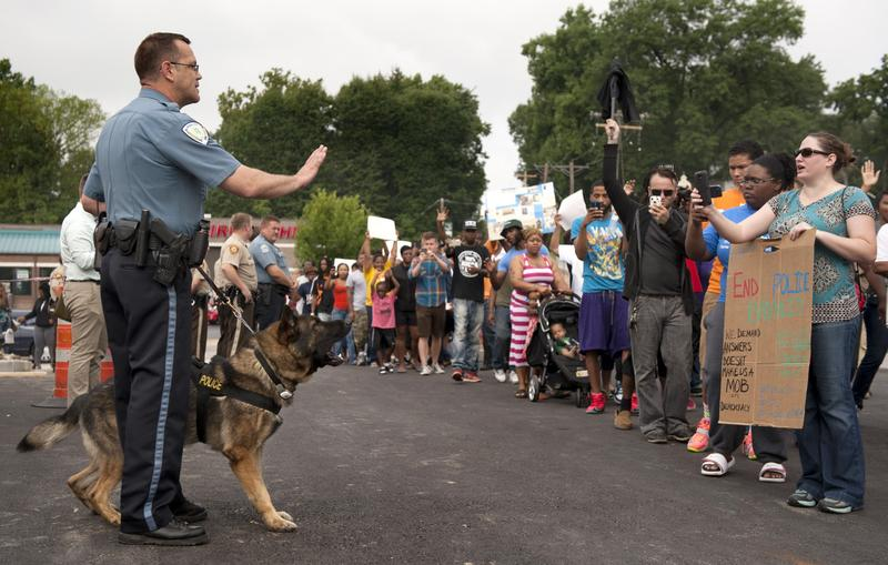 Protestors confront police during an impromptu rally, Sunday, Aug. 10, 2014 to protest the shooting of Michael Brown, 18, by police in Ferguson, Mo.  Saturday, Aug. 9, 2014. Brown died following a confrontation with police, according to St. Louis County Police Chief Jon Belmar, who spoke at a news conference Sunday. (Sid Hastings/AP)