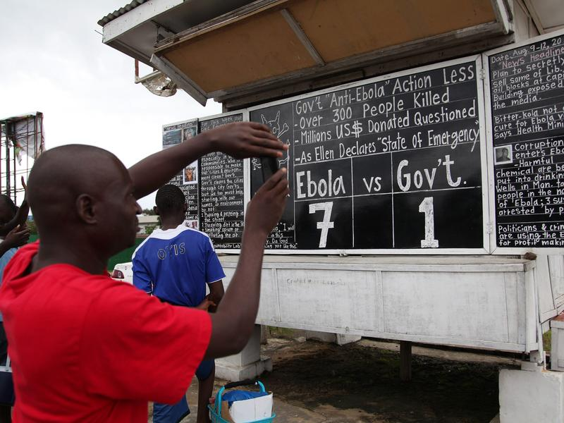 Radio, TV and newspapers aren't the only media used in Liberia to keep the public informed about Ebola. In the capital city of Monrovia, a chalkboard features the latest news about the virus.