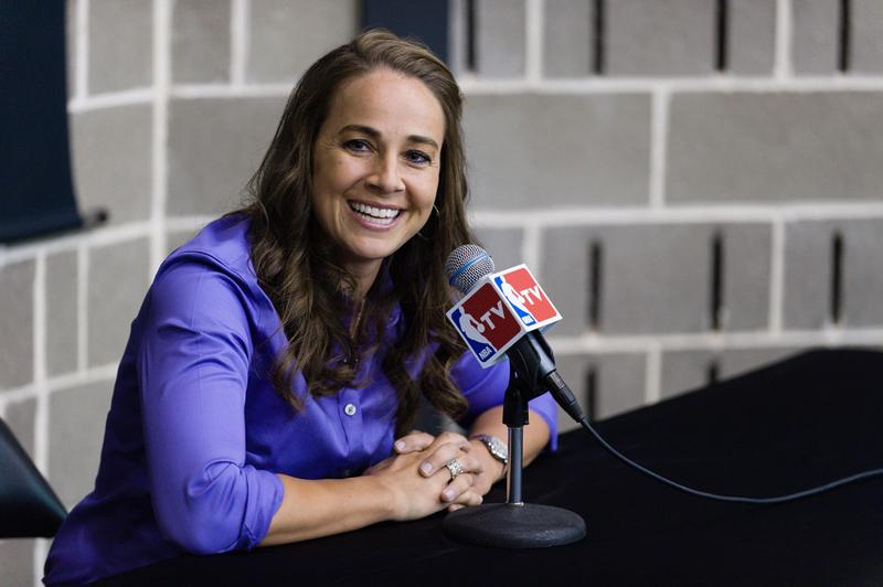 WNBA star Becky Hammon takes questions from the media at the San Antonio Spurs practice facility after being introduced as an assistant coach with the team on Tuesday, Aug. 5 in San Antonio. Hammon became the first woman to be a full-time, paid assistant on an NBA staff. (Bahram Mark Sobhani/AP)