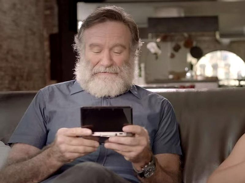 Robin Williams and daughter Zelda Williams play the Nintendo 3DS in an image from a promotional video. Williams, an avid gamer, died earlier this week.