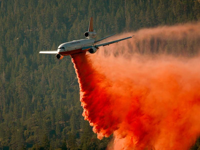 A DC-10 firefighting aircraft drops fire retardant in northern California in 2008. As the Forest Service expands and modernizes its fleet of air tankers, it has recently added several DC-10s.