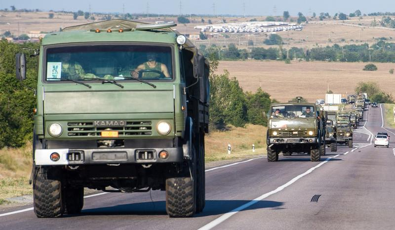 A column of military vehicles drives on a road near the town of Kamensk-Shakhtinsky in the Rostov region, some 30 km from the Russian-Ukrainian border, on August 15, 2014. Ukrainian officials were preparing to inspect a massive Russian 'aid' convoy bound for the conflict-torn east on August 15 after Russian armoured vehicles crossed the border, fueling fears Moscow is trying to bolster the unraveling insurgency. The Ukrainian military had announced that checks had begun on the near 300-truck convoy but later said only that 59 border and customs officials had arrived at a Russian border post to prepare to carry out the inspections. (Dmitry Serebryakov/AFP/Getty Images)