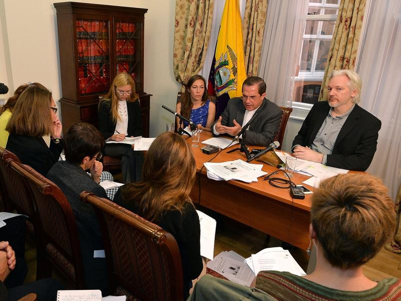 WikiLeaks founder Julian Assange (right) said he'll leave the Ecuadorian Embassy in London, at a news conference with Ecuador's Foreign Minister Ricardo Patino. Assange has been holed up at the embassy for two years.