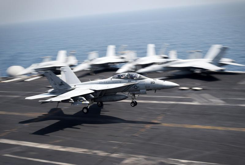 An F/A-18C Hornet coming from Iraq lands on the flight deck of the US navy aircraft carrier USS George H.W. Bush on August 15, 2014 in the Gulf.  (Mohammed Al-Shaikh/AFP/Getty Images)