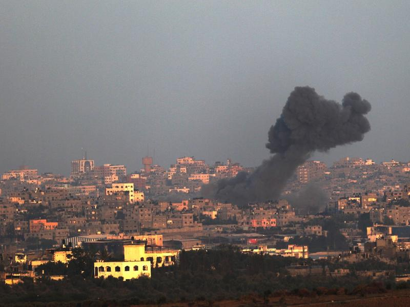 Black smoke billows in the distance following an Israeli airstrike from the northern Gaza Strip on Wednesday.