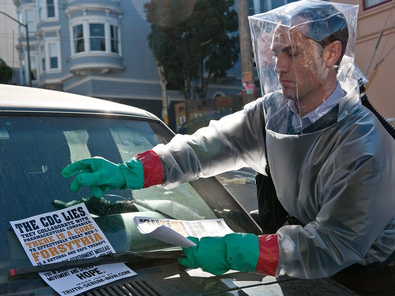 Jude Law prepares for the looming pandemic in the 2011 movie <em>Contagion</em>. There are huge differences between viruses in movies and Ebola in real life.