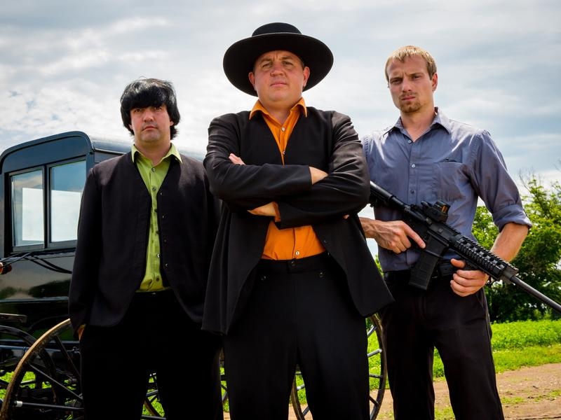 Lebanon Levi (center) is depicted as the ringleader in Discovery's <em>Amish Mafia</em>. Locals in Lancaster County, Pa., say the reality TV show and its spinoffs are offensive fabrications.