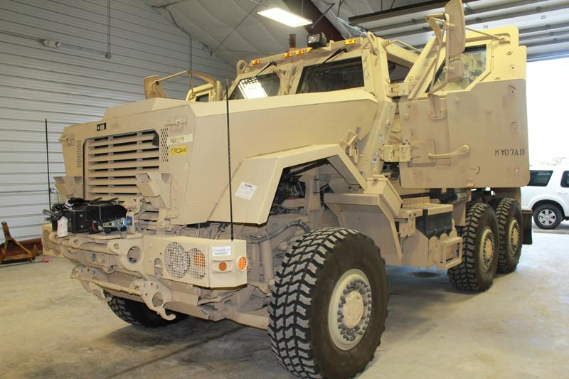 This Mine Resistant Ambush Protected vehicle, or MRAP, was obtained by the Clay County Sheriff's Department in April. Because of it's size, it's housed at the county's highway department, where snow plows and large mowers are parked. (Peggy Lowe/KCUR)