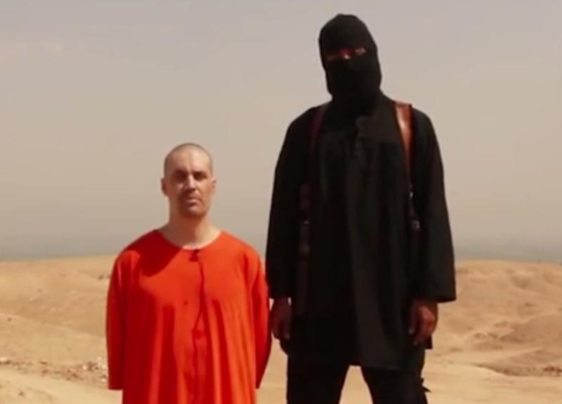 American journalist James Foley (left) is pictured in a screenshot from the video in which he was beheaded by an Islamic State militant.