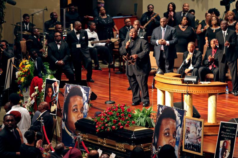 People attend the funeral of Michael Brown inside Friendly Temple Missionary Baptist Church on August 25, 2014 in St. Louis Missouri. (Robert Cohen/Getty Images)