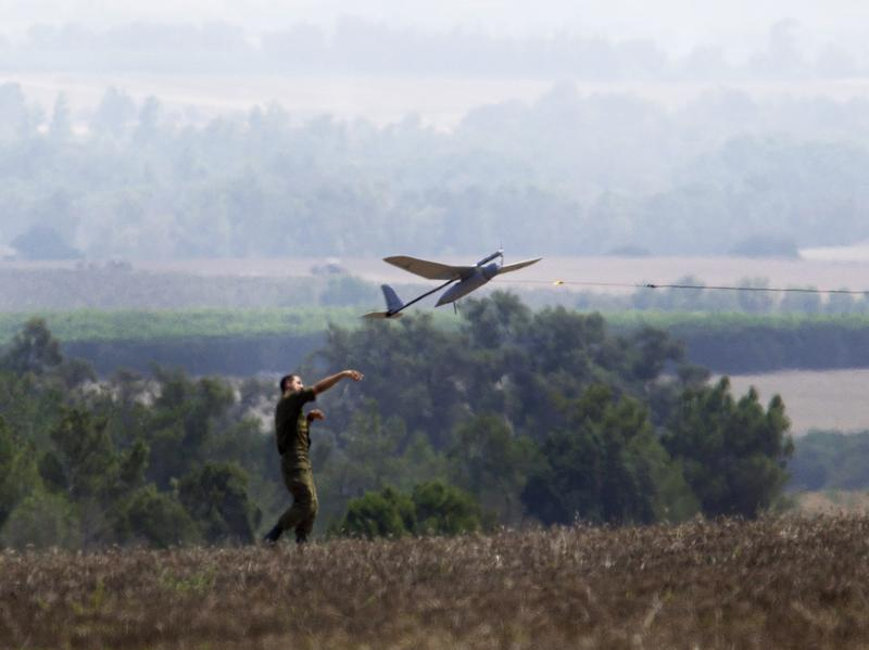 An Israeli soldier launches a  drone that's attached to a military vehicle in southern Israel, not far from the border with the Gaza Strip, on July 29. Israel was a pioneer with drones and has developed a number of military technologies that it later sells abroad.