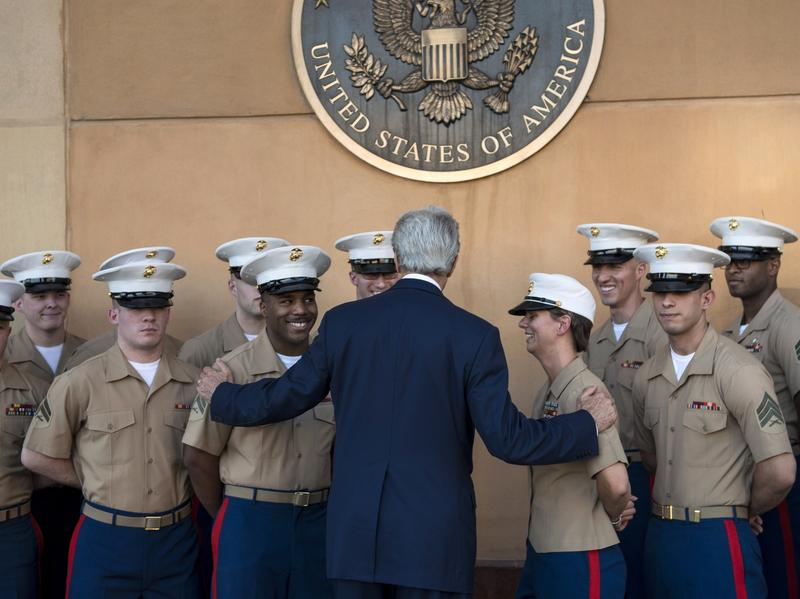 U.S. Secretary of State John Kerry greets U.S. Marines as he arrives June 23 at the American Embassy in the International Zone in Iraq's capital, Baghdad.