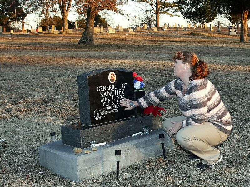 Jeana West touches the headstone of her son, Generro Sanchez, at a cemetery in Stuart, Okla., in February. He was killed by a college classmate who was found to have antisocial personality disorder.