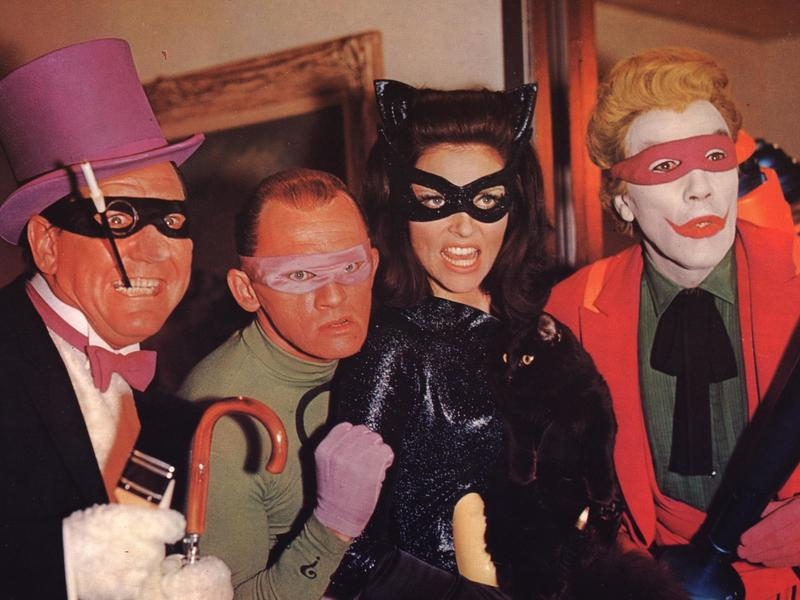 Who are these people? It's impossible to tell, they're wearing masks. (Ok yeah it's Burgess Meredith, Frank Gorshin, Lee Meriweather, and Cesar Romero in 1966's <em>Batman</em>.)