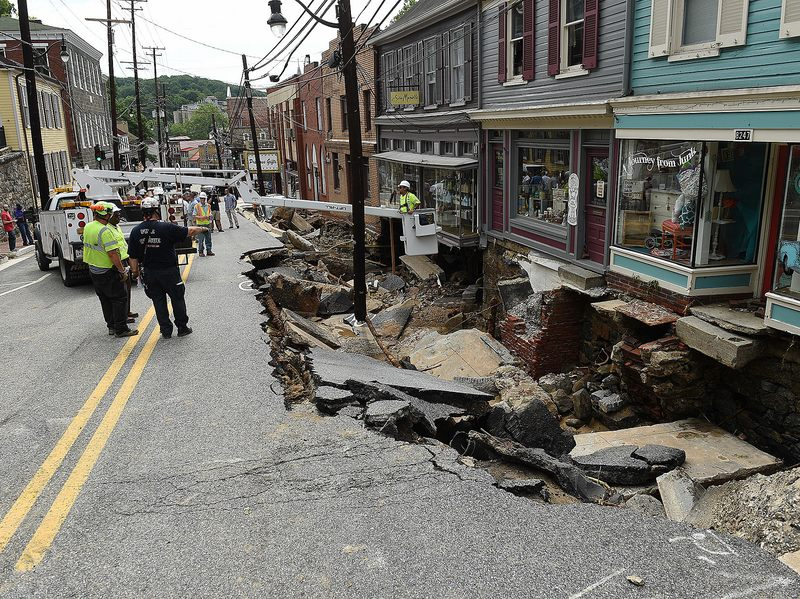 Rescue workers on Sunday look at the destruction caused by a flash flood on Main Street in Ellicott City, Md.