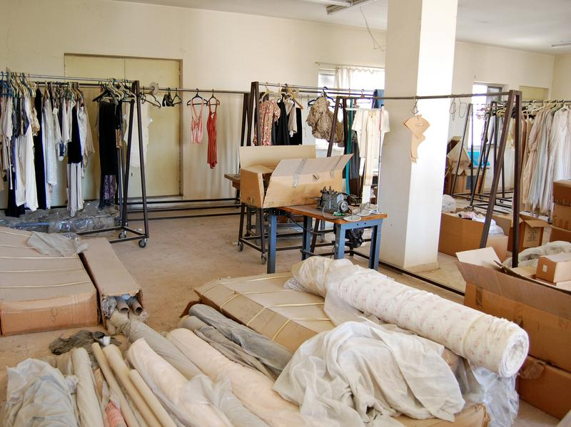 The lingerie factory was opened in the West Bank in the 1980s in an attempt to develop the Palestinian economy. The factory was shut in 1990 amid bouts of West Bank violence and troubles with Israeli military regulations. Racks of robes and camisoles still hang in the production room.