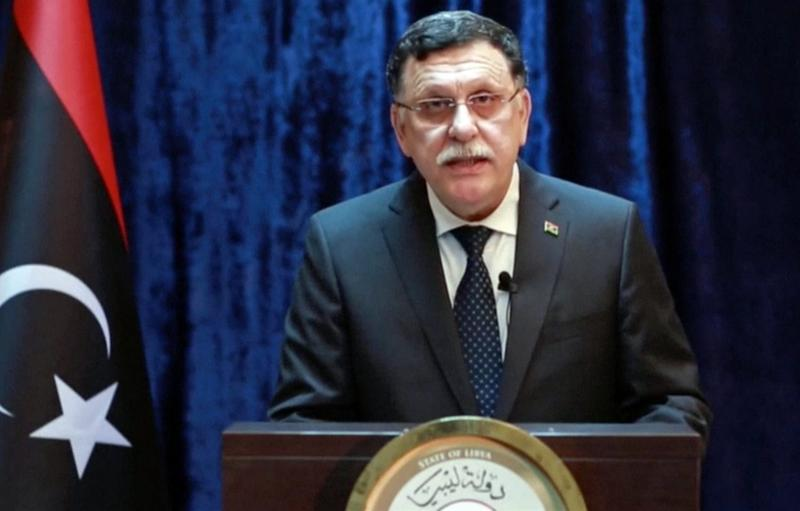 In this Monday, Aug. 1, 2016 frame grab from video by the Libyan Government Media Office, Fayez Serraj, the head of Libya's U.N.-brokered presidency council, makes a statement on Libyan TV announcing that American warplanes attacked the IS bastion of Sirte on the Mediterranean Sea, in northern Libya. (Libyan Government Media Office via AP)