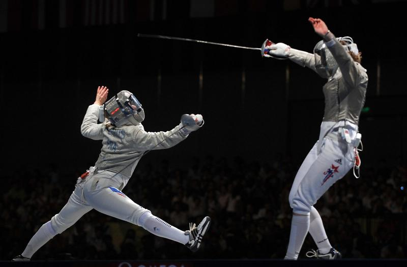 American Sada Jacobson (L) competes against France's Leonore Perrus during the women's team sabre bronze medal match France vs. USA on August 14, 2008 at the Fencing Hall of National Convention center, as part of the 2008 Beijing Olympic Games. (Philippe Desmazes/AFP/Getty Images)