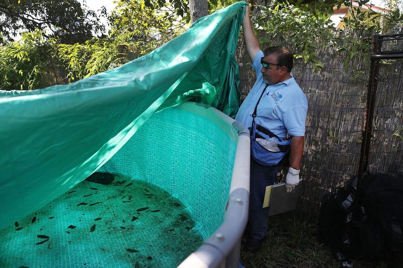 Robert Muxo, a Miami-Dade County mosquito control inspector, inspects a property for mosquitos or breeding areas in the Wynwood neighborhood as the county fights to control the Zika virus outbreak on July 30, 2016 in Miami, Florida. (Joe Raedle/Getty Images)