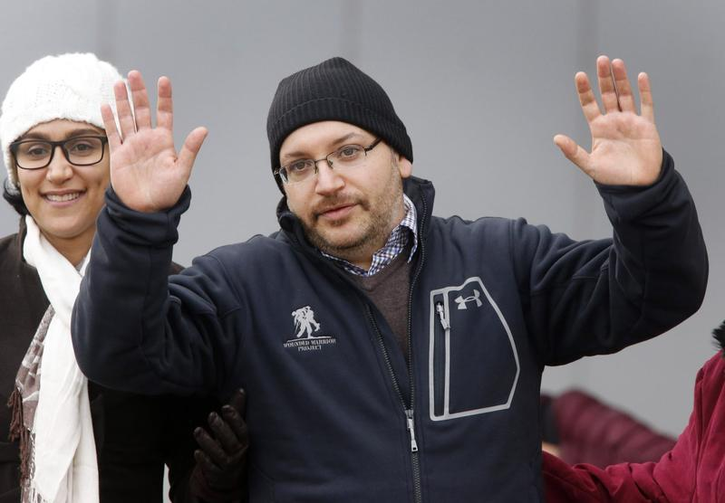 U.S. journalist Jason Rezaian gestures next to his wife Yeganeh Salehi as he poses for media people in front of Landstuhl Regional Medical Center in Landstuhl, Germany, Wednesday, Jan. 20, 2016, shortly after being released from an Iranian prison. (Michael Probst/AP)
