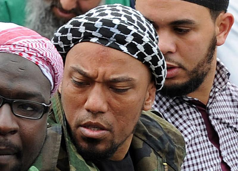 A picture taken on May 5, 2012 shows former German rapper Denis Cuspert (C) among salafi in Bonn, Germany. (Henning Kaiser/AFP/Getty Images)