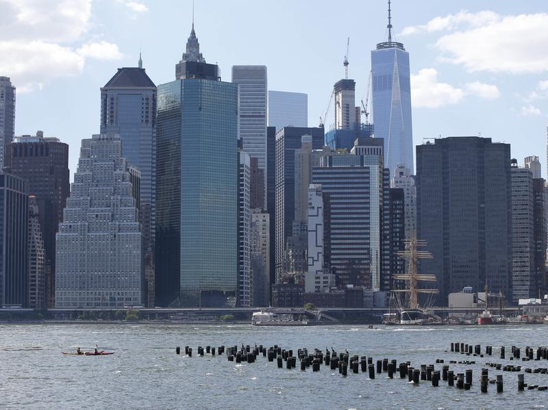 Kayakers paddle in the East River in front of the Lower Manhattan skyline in June 2016.