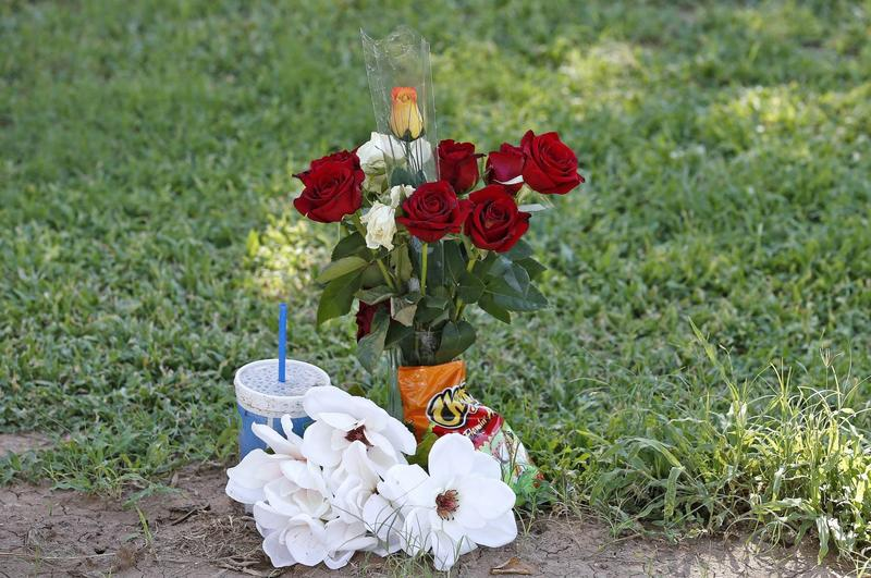 "The grave site of Manuel ""Manny"" Castro Garcia, 19, at a cemetery Thursday, July 14, 2016, in Phoenix. The teen was killed in June, and is one of a growing number of victims associated with a serial killer according to police. (Ross D. Franklin/AP)"