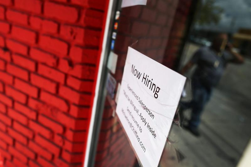 A now hiring sign is seen in the window of a business on April 1, 2016 in Miami, Florida. (Joe Raedle/Getty Images)
