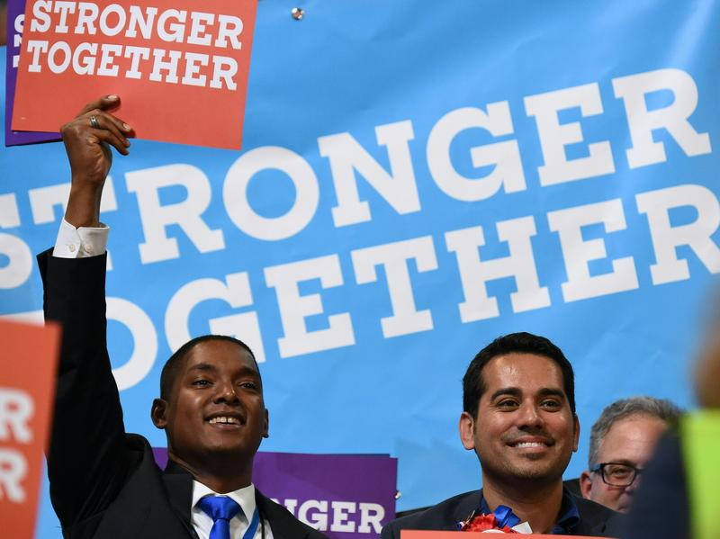 Delegates hold up signs with the Clinton campaign slogan during last month's Democratic National Convention in Philadelphia.