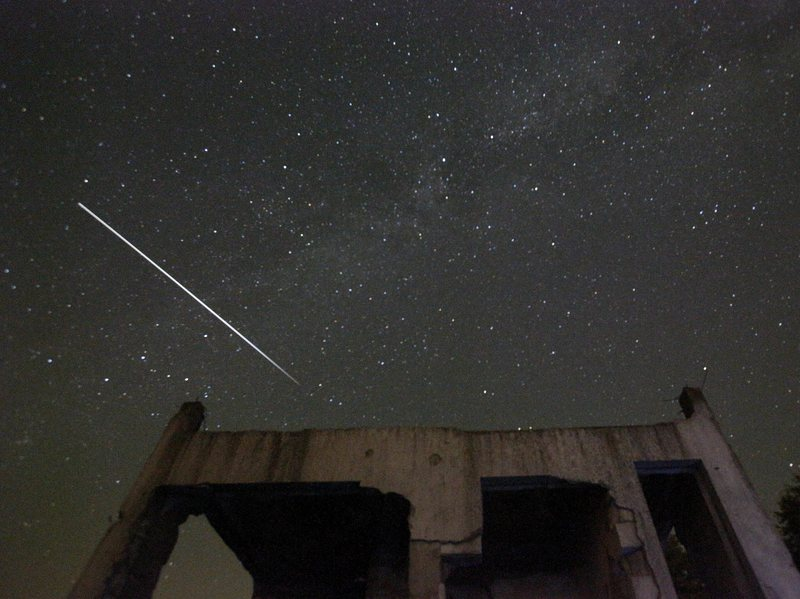 Stars and Perseid meteor streaks are seen behind a destroyed house near Tuzla, Bosnia, in 2015.