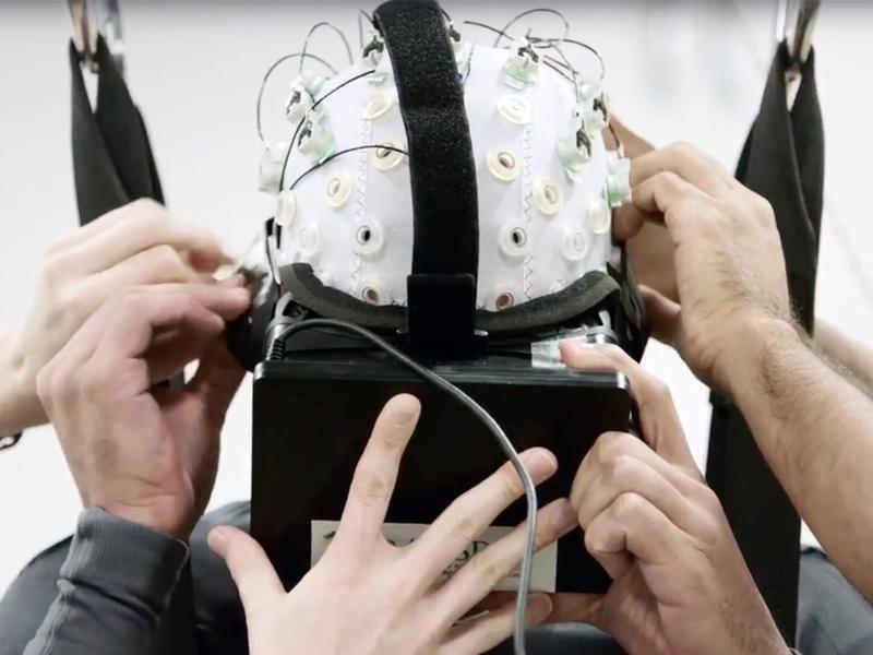 """Scientists with the international scientific collaboration known as the """"Walk Again Project"""" use noninvasive brain-machine interfaces in their efforts to reawaken damaged fibers in the spinal cord."""