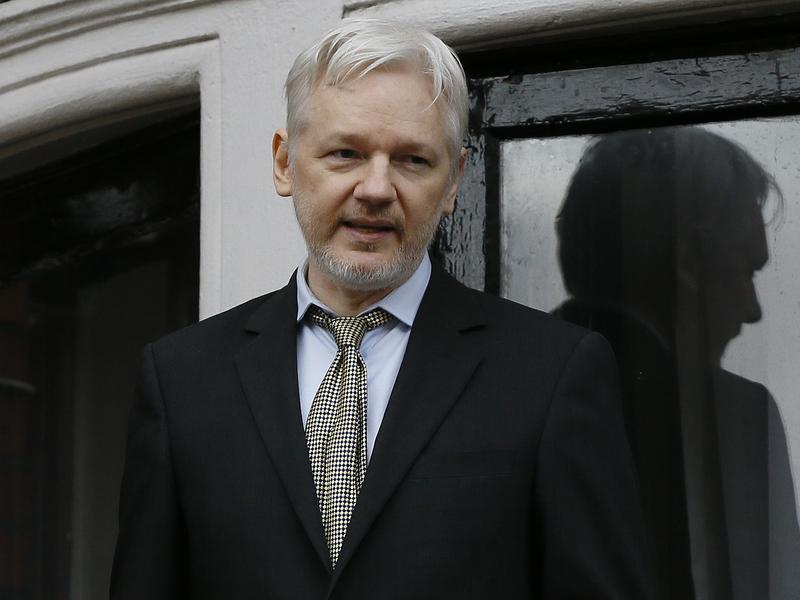 Wikileaks founder Julian Assange speaks from the balcony of the Ecuadorean Embassy in London in February 2015.