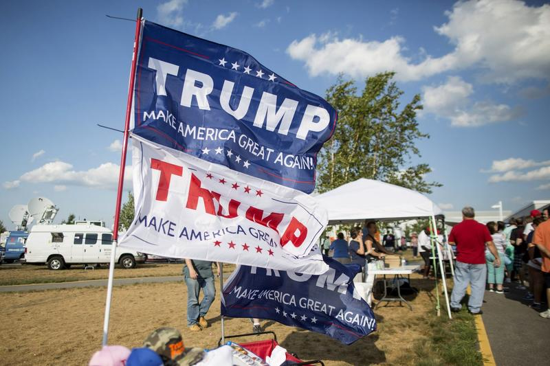 Flags for Republican presidential candidate Donald Trump fly outside his rally at Windham High School on Aug. 6, 2016 in Windham, New Hampshire. (Scott Eisen/Getty Images)