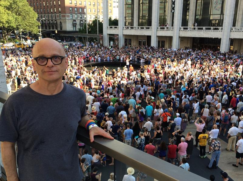Pulitzer Prize-winning composer David Lang on the balcony of David Geffen Hall while 1,000 people gathered below him on the Lincoln Center Plaza, in New York to sing one of his new pieces.