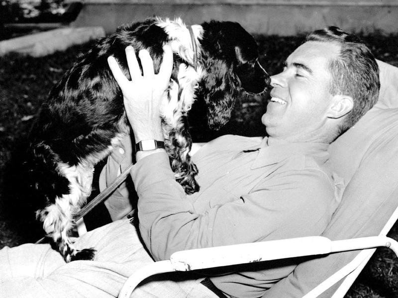 Richard M. Nixon with Checkers, his family's cocker spaniel, in 1952. Nixon, who was then the Republican vice presidential nominee, mentioned Checkers in a TV-radio report on his finances.